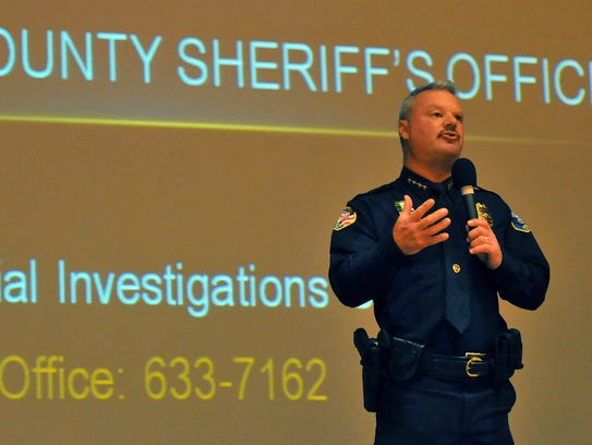 Satellite Beach Police Chief Jeff Pearson addresses the crowd during a March 2015 crime forum event at Satellite High.