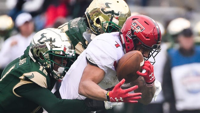 Texas Tech Red Raiders running back Justin Stockton (4) carries the ball against South Florida Bulls safety Jaymon Thomas (18) during the 2017 Birmingham Bowl at Legion Field.