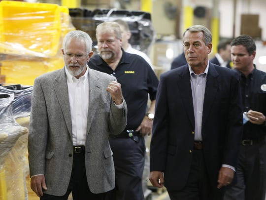 House Speaker John Boehner took a short walking tour through Kaivac Cleaning Systems in Hamilton on Thursday, escorted by founder/owner Bob Robinson Sr.