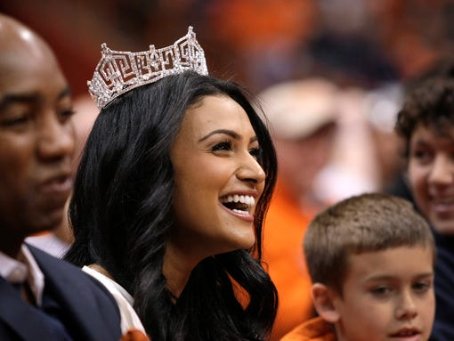 FILE - In this Saturday, Feb. 15, 2014, file photo, Miss America 2014 Nina Davuluri attends the NCAA college basketball game between Syracuse and North Carolina State in Syracuse, N.Y. A Pennsylvania high school student is in hot water for asking Davuluri to prom during a question and answer session at school. Eighteen-year-old Patrick Farves said he received three days of in-school suspension Thursday, April 17, 2014, because he asked Davuluri to prom. School officials heard about Farves' plan in advance and warned him not to do it. He has apologized for disrupting the event. (AP Photo/Nick Lisi, File)