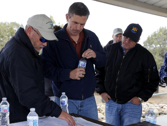 Bureau of Land Management outdoor recreation planner Doug McKim shows U.S. Sen. Martin Heinrich and County Executive Officer Kim Carpenter a map of the Brown Springs recreation site in the Glade Run Recreation Area Wednesday near Farmington.