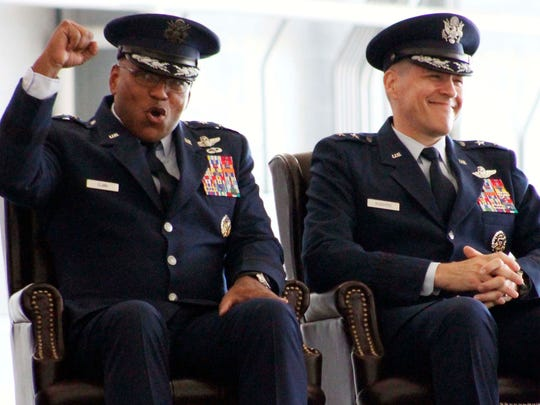 Outgoing Commander Maj. Gen. Richard Clark(left) sits by his replacement Maj. Gen. Thomas Bussiere who will assume command of the 8th Air Force at Barksadale Air Force Base Tuesday Oct. 4 in Bossier City.