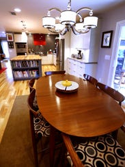 Eat at a large dining table in the home of Wanda and