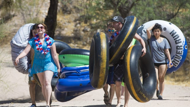 Tubers head towards the Salt River in Mesa over Memorial Day weekend on May 29, 2017.