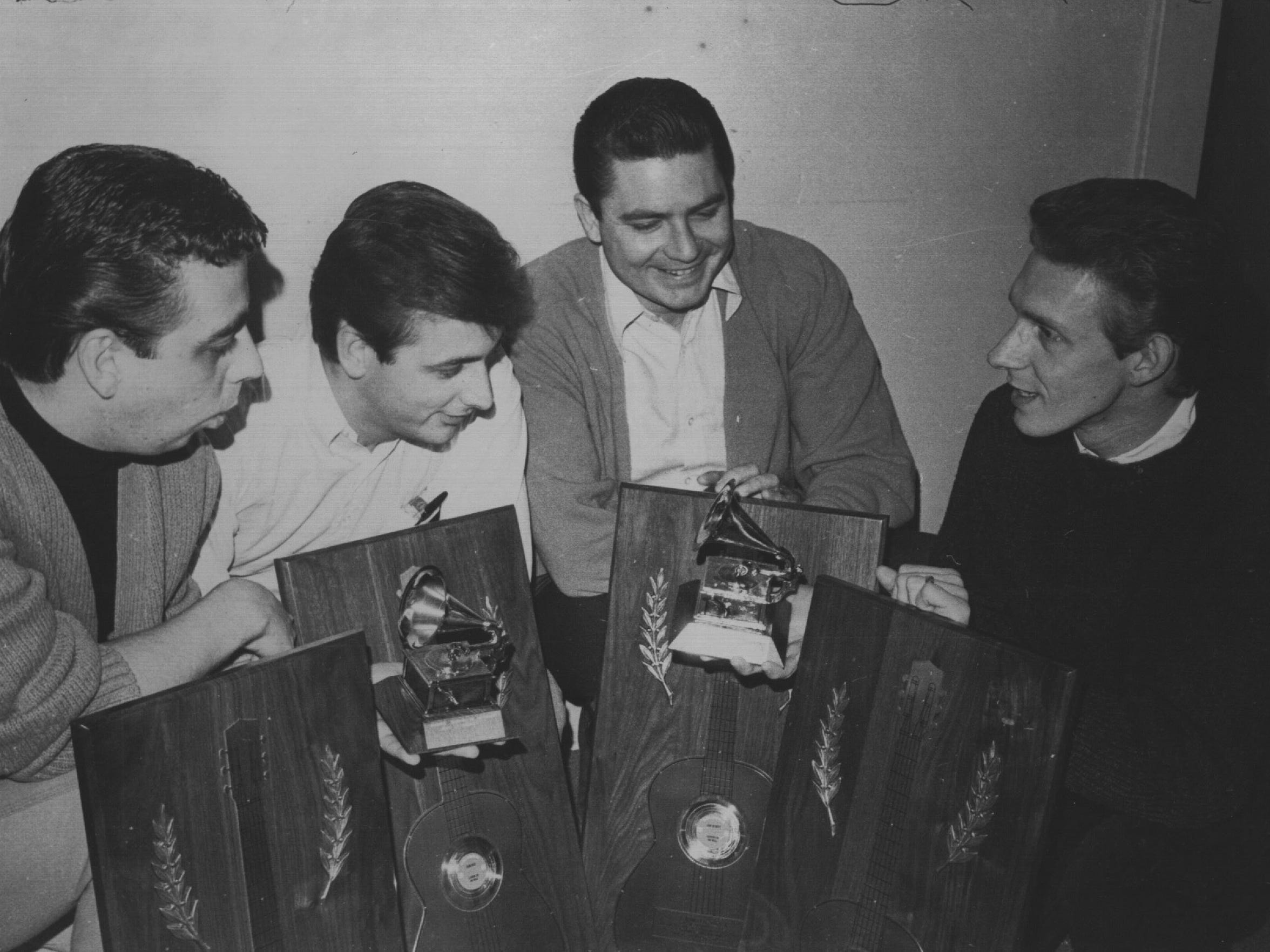 The Statler Brothers admire their 1966 Grammy award
