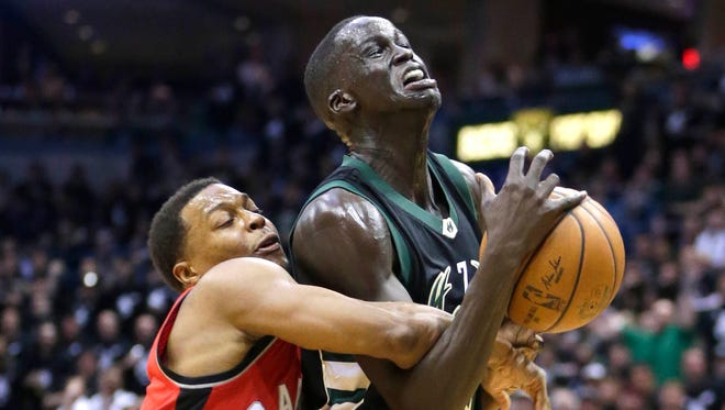 Bucks forward Thon Maker is fouled by Raptors guard Kyle Lowry during Milwaukee's 107-77 win.