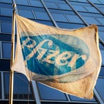 A Pfizer flag is displayed in front of the company's corporate headquarters  Nov. 23, 2015, in New York.