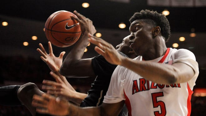 Jan 15, 2015; Tucson; Arizona Wildcats forward Stanley Johnson (5) attempts to grab a rebound against the Colorado Buffaloes during the first half at McKale Center.