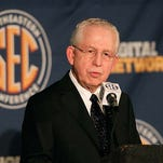 SEC commissioner Mike Slive talks with the media during the 2013 SEC football media days at the Hyatt Regency. Mandatory Credit: Marvin Gentry-USA TODAY Sports
