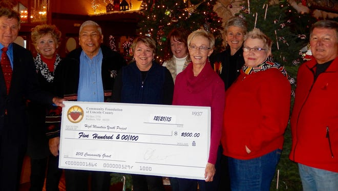 Representatives of the Community Foundation of Lincoln County stand with board members of the High Mountain Youth Project. The foundation, which raises funds for a wide array of local non-profit groups, donated $500 to High Mountain's effort to create a service center for homeless youth in Ruidoso.