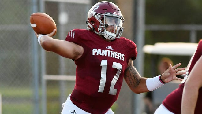 FLORIDA TECH QB Mark Cato passes the ball during Saturday's game at Panther Stadium