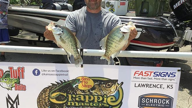 Clinton, Mo., resident Mike Vallentine, owner and president of the national Crappie Masters All-American Tournament Trail, shows his largest crappie during a Kansas Crappie Trail tournament weigh-in May 23 at Melvern Reservoir. Vallentine finished fourth in that tournament. This year marks the first for the KCT under the Crappie Masters umbrella.