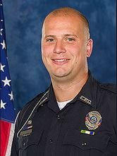 Michael J. Metzger, a two-year veteran of the Elsmere Police Department, was named by Kentucky State Police Tuesday as being involved in the officer-involved shooting in the Heartland Pointe Mobile Home Park.