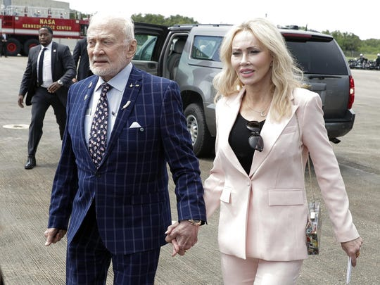 Apollo 11 astronaut Buzz Aldrin, left, and Anca Faur arrive at the Kennedy Space Center for a visit in recognition of the Apollo 11 moon landing anniversary, Saturday, July 20, 2019, in Cape Canaveral, Fla. (AP Photo/John Raoux)