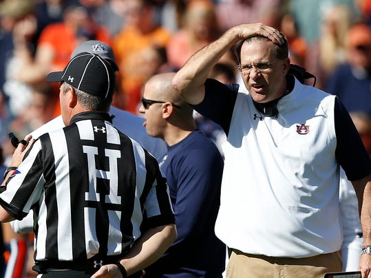 FILE - In this Nov. 5, 2016, file photo, Auburn head coach Gus Malzahn reacts after Auburn linebacker Deshaun Davis is ejected from the game after a targeting call during the first half of an NCAA college football game against Vanderbilt in Auburn, Ala. College football's most hated rule turns five years old in 2017. Targeting, which penalizes players for hits to the head with ejections, drives coaches, players and especially fans crazy, is here to stay and its supporters are adamant that it is a necessary part of the evolution of college football. (AP Photo/Brynn Anderson, File)