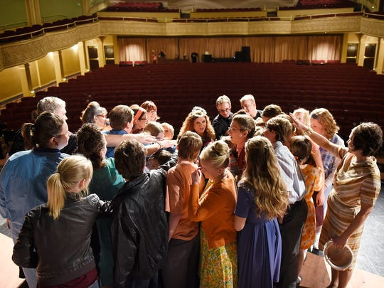 """Cast members gather in a huddle Friday before the opening show of GREAT Theatre's production of """"The Best Christmas Pageant Ever"""" at the Paramount Theatre in St. Cloud."""