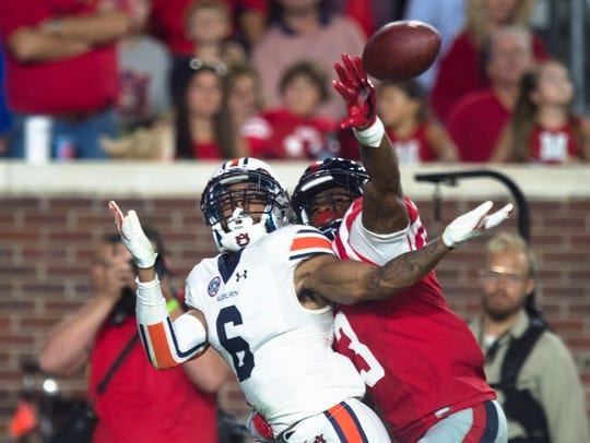 Auburn defensive back Carlton Davis (6) attempts to