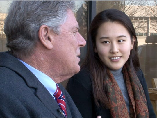 Rutgers University Newark sophomore Esder Chong listens