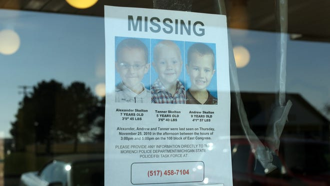 A flier is posted in the effort to locate the Skelton brothers; Tanner, 5, Alexander, 7, and Andrew, 9, in Morenci,  Mich., Nov.28, 2010.