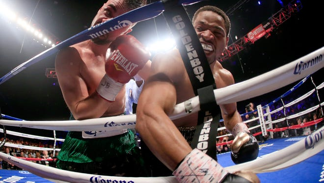 Shawn Porter, right, lands a punch on Paulie Malignaggi during their IFB Welterweight Title fight Saturday