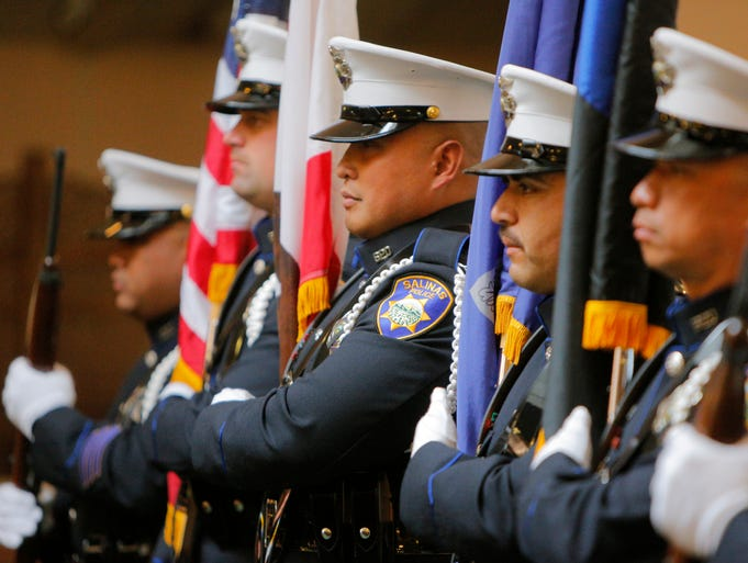 The honor guard posts colors for the 20th Annual Monterey County Law Enforcement Memorial on Wednesday at St. Jude Church in Marina.