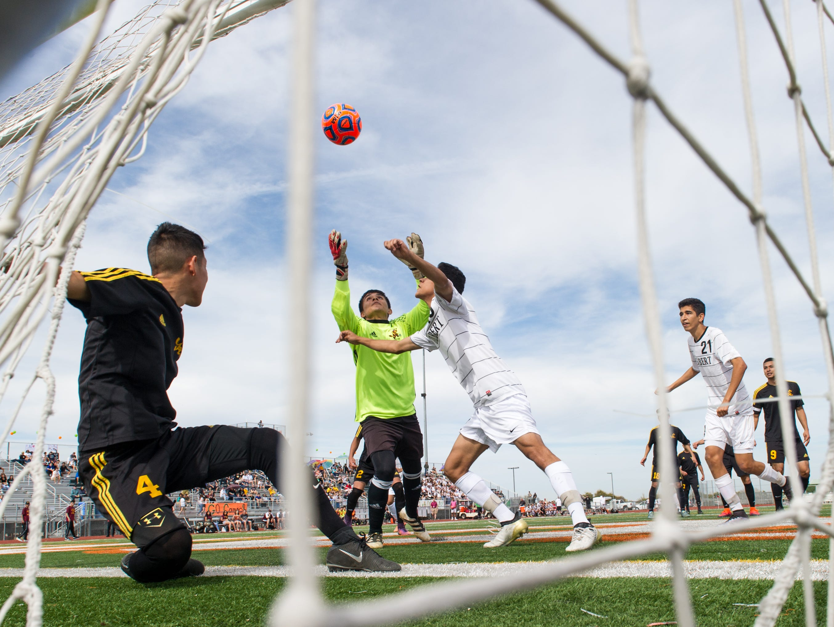 Tolleson's Alan Cazares (0) saves a goal Gilbert's Moises Serda Sevilla (13) during the first half of their 6A Conference state championship game on Saturday.