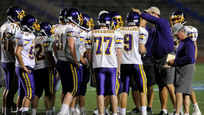 Wylie head coach Hugh Sandifer talks to the offense during Thursday's scrimmage against San Angelo Lake View.