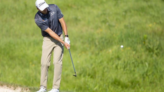 Richy Werenski, a Georgia Tech graduate, chips on the 18th hole of the during the first round of the 3M Open tournament in Blaine, Minn., on Thursday.
