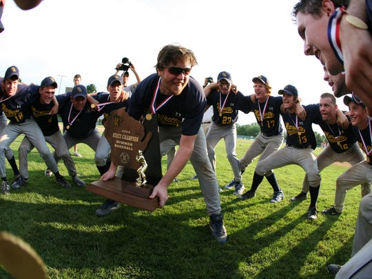 Marquette first baseman Dan Leveritt leads the victory chant after their 5-3 win over Arrowhead for the summer baseball title in 2006.