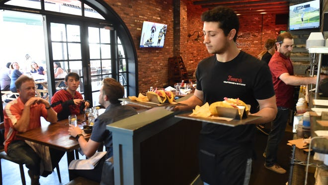 Michael Baker serves lunch at Finney's Crafthouse and Kitchen in Thousand Oaks.