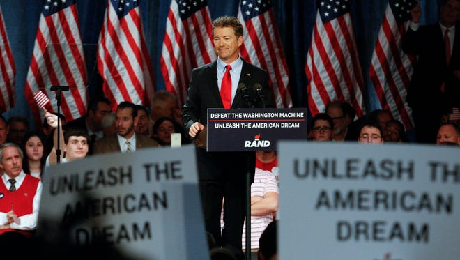 Sen. Rand Paul smiles at the crowd as he announces that he will be seeking the White House in 2016 during a speech at the Galt House in Louisville.  Apr. , 2015