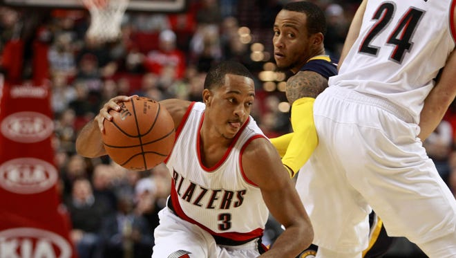Portland Trail Blazers guard C.J. McCollum (3) drives to the basket as Indiana Pacers guard Monta Ellis defends during the first half of an NBA basketball game in Portland, Ore., Thursday, Dec. 3, 2015.
