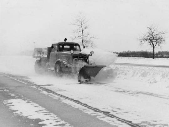 A State Highway truck clears snow in this 1958 image.