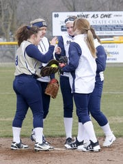 Notre Dame players talk at the mound Thursday during a 15-0 home win over Newfield.