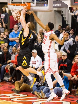 Ohio State's Keita Bates-Diop (33) blocks a shot by Iowa guard Mike Gesell (10) that would have tied the game late at Value City Arena.
