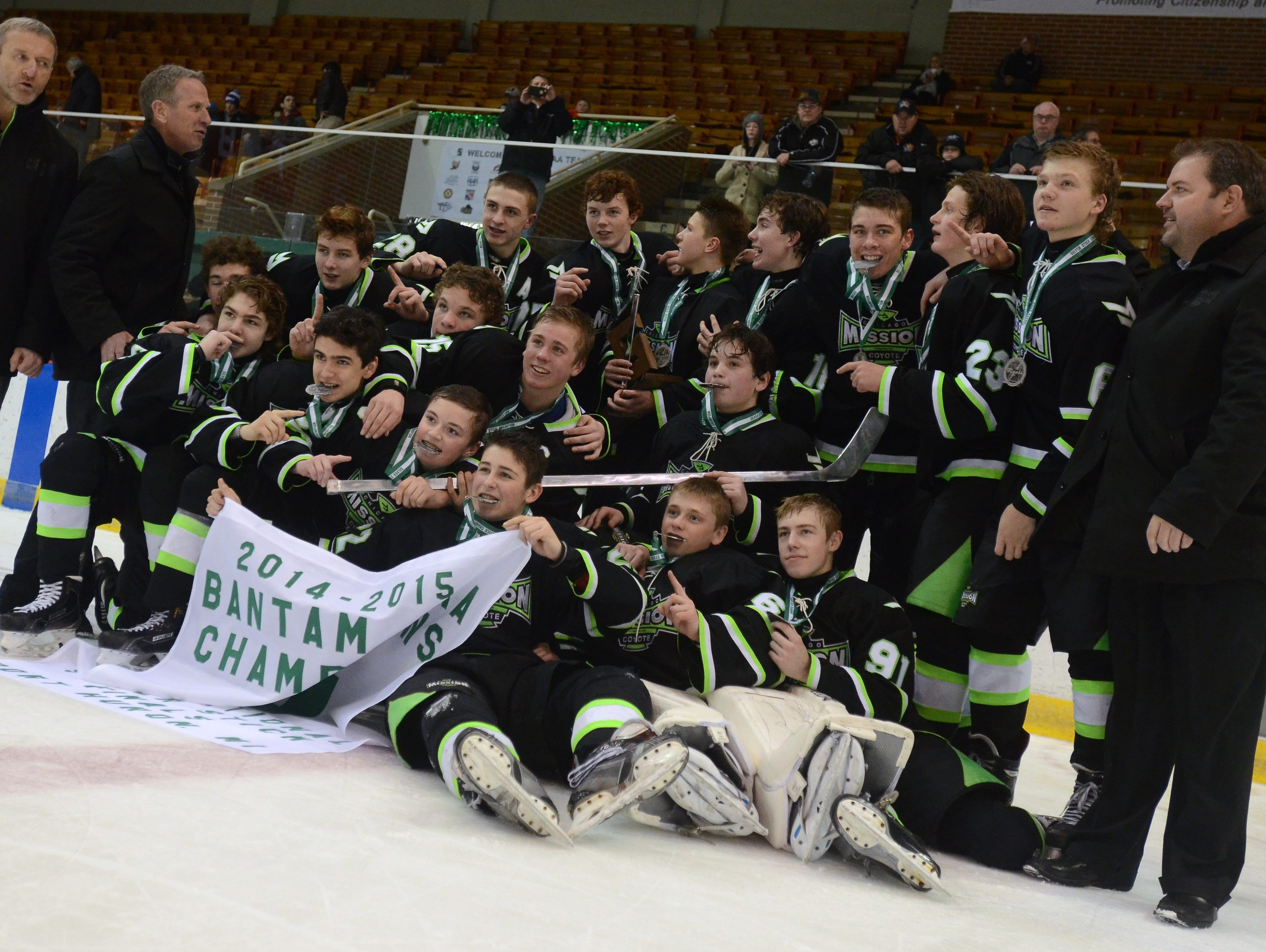 Members of the Chicago Mission celebrate Sunday, Jan 11 after winning the Bantam AAA Silver Stick Finals championship game.