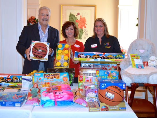 VBCBA vice president Bart Mazzarella presents toys