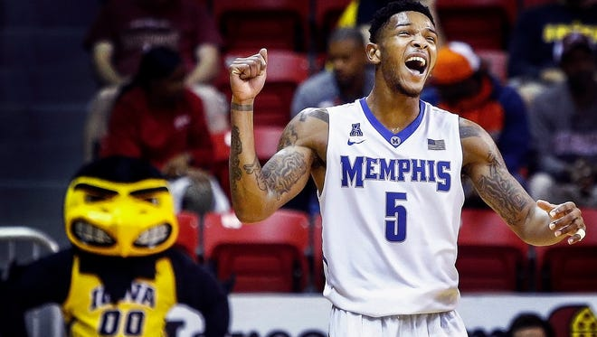 University of Memphis guard Markel Crawford celebrates during the final seconds of a 100-92 victory over Iowa University during the third place game at the Emerald Coast Classic in Niceville, Florida.