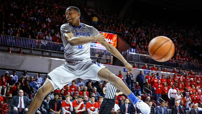 University of Memphis guard Jeremiah Martin saves the ball from going out of bounds against the Southern Methodist University defense during first half action at Moody Coliseum in Dallas on Saturday, March 4, 2017.