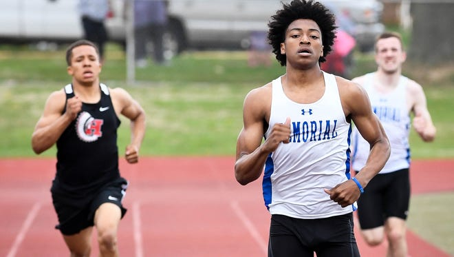Memorial's Dylan Penn enters the home stretch en route to winning the boys' 400 with a personal record time of 50.0 Friday at the City track meet at Central Stadium.