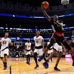 Callaway and West guard Malik Newman (14) and teammate P.J. Dozier (15) watch as East forward Jaylen Brown (1) shoots the ball during the first half of the McDonald's All American game at the United Center in Chicago.
