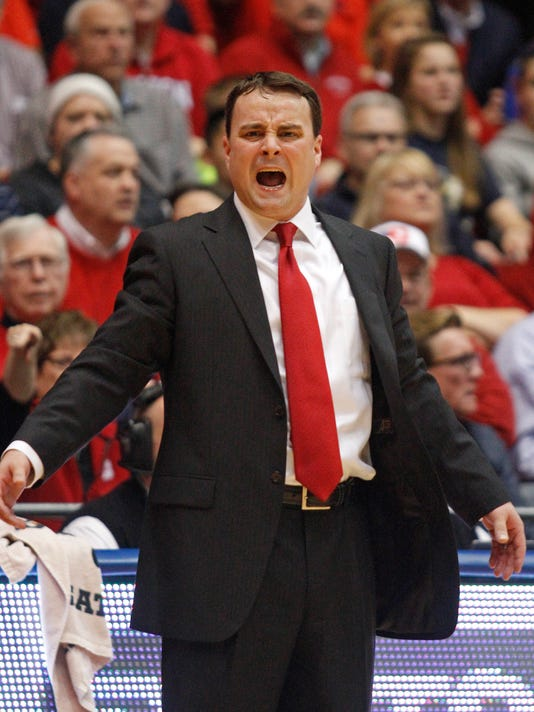 Dayton coach Archie Miller shouts at his players in the first half of an NCAA college basketball game against Georgia Tech, Tuesday, Dec. 23, 2014, in Dayton, Ohio. (AP Photo/Skip Peterson)