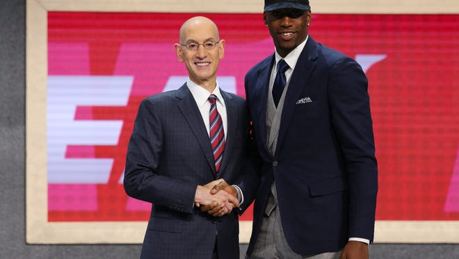 Jun 22, 2017; Brooklyn, NY, USA; Bam Adebayo (Kentucky) is introduced by NBA commissioner Adam Silver as the number fourteen overall pick to the Miami Heat in the first round of the 2017 NBA Draft at Barclays Center.
