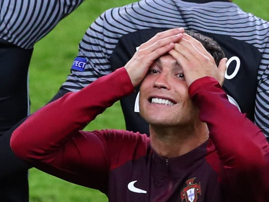 Portugal's Cristiano Ronaldo celebrates after his team won the Euro 2016 final soccer match between Portugal and France at the Stade de France in Saint-Denis, north of Paris, Sunday, July 10, 2016. (AP Photo/Thibault Camus)