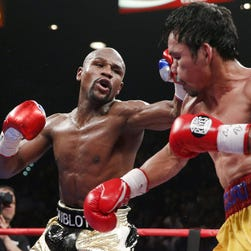 eFloyd Mayweather Jr. (L) throws a left against Manny Pacquiao during their welterweight unification championship boxing fight at the MGM Grand Garden Arena in Las Vegas, Nevada, USA, on 02 May 2015.  EPA/ESTHER LIN ORG XMIT: GRA03