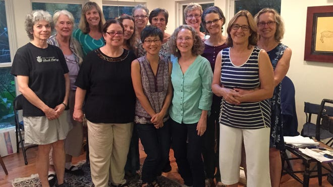 Threshold Choir members joined together for a group photo