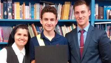 Dominick Forgen (center) receives his prizes for winning first place in the writing/video contest recently sponsored by the Vineland Historical and Antiquarian Society. He is pictured with Sister Rosa Maria Ojeda, principal of Bishop Schad Regional School, and Richard Salls Jr., an account manager with W.B. Mason, the office supply store, which provided a $50 gift card as a prize.