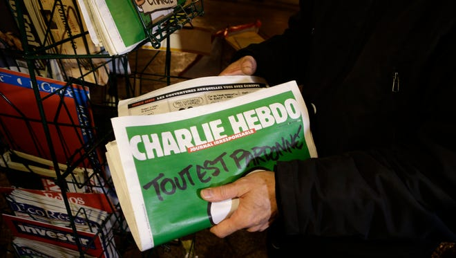 The most recent edition of Charlie Hebdo, folded over.