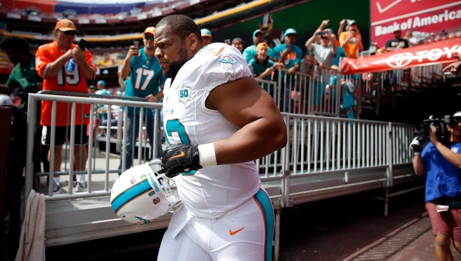 Miami Dolphins defensive tackle Ndamukong Suh runs on the field before a game against the Washington Redskins on Sunday, Sept. 13, 2015, in Landover, Md.