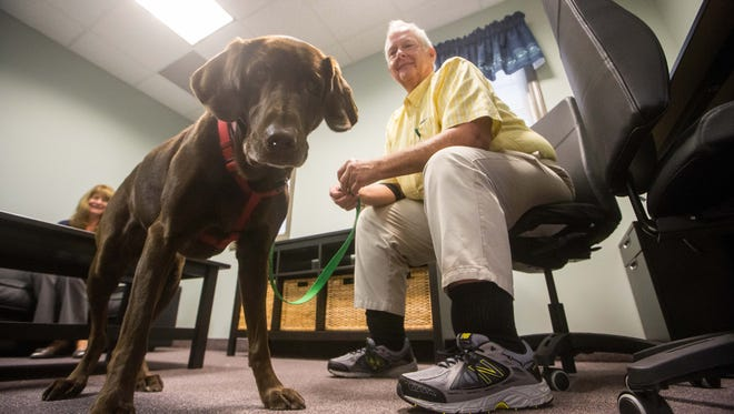 Rick Altemus and his therapy dog, Chip, interacting at Cecil County's Child Advocacy Center.